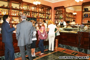 Italians enjoying themselves ina coffee bar: Photo from travel.cnn.com